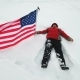 Man Is Waving US Flag Lies in the Snow - VideoHive Item for Sale