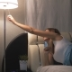 Woman Wakes Up At Night Turns On The Lamp Takes And Turns On The Phone - VideoHive Item for Sale