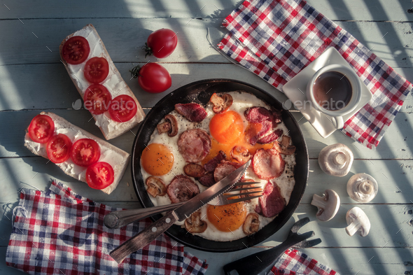 Delicious breakfast with fried eggs - Stock Photo - Images