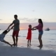 Happy Beautiful Family on a Beach During Summer Vacation at Sunset - VideoHive Item for Sale