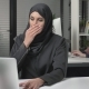 Girl in Black Hijab Sits in the Office and Coughs, a Disease, a Cold, an Illness Is a Concept - VideoHive Item for Sale