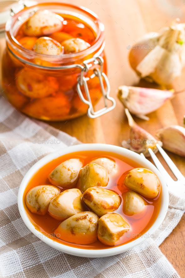 Tasty preserved garlic. - Stock Photo - Images