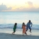 Father and Kids Enjoying Beach Summer Tropical Vacation at Sunset. - VideoHive Item for Sale