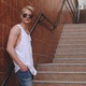 Young hipster man posing standing on the stairs - PhotoDune Item for Sale