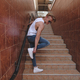 Male binds the shoelaces while climbing on stairs - PhotoDune Item for Sale