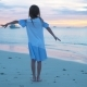 Sihouette of Little Girl Dancing on the Beach at Sunset. - VideoHive Item for Sale
