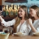 Two Beautiful Women Taking Selfie in Cafe - VideoHive Item for Sale