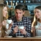 Group of Friends Drinking Coffee and Talking In Cafe - VideoHive Item for Sale