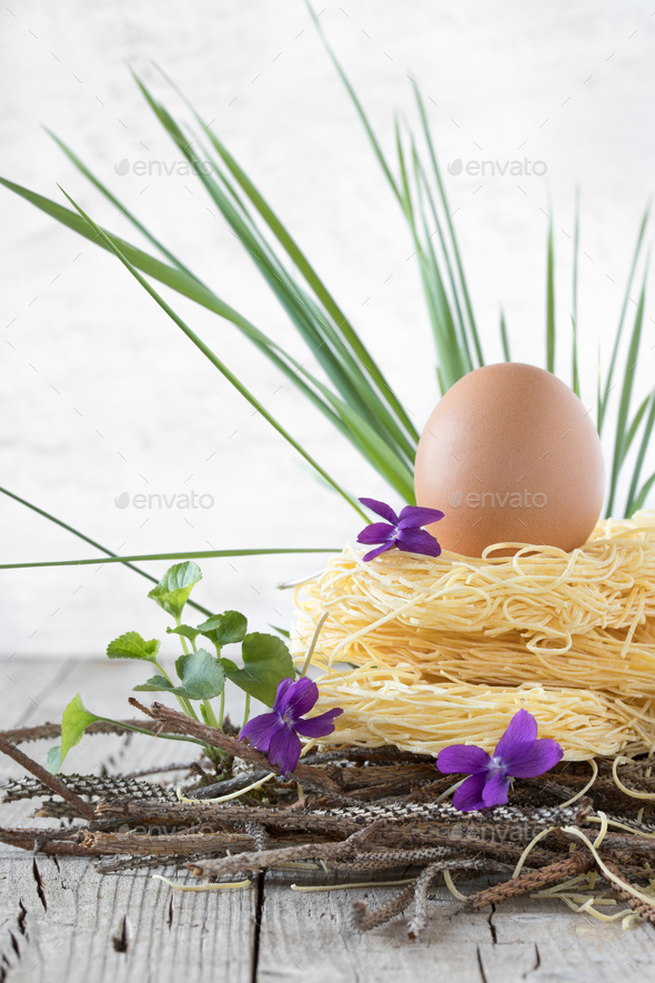 Nest Of Raw Pasta With Egg - Stock Photo - Images