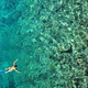 Aerial view of woman snorkeling in tropical sea water. Drone view - PhotoDune Item for Sale