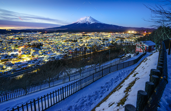 Mt Fuji and Fujiyoshida city at twilight, Japan - Stock Photo - Images