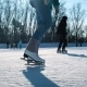 Young Woman Skating on Ice with Figure Skates Outdoors in the Snow - VideoHive Item for Sale