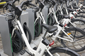 Charging electric bikes in the city. Urban green transportation. Horizontal - PhotoDune Item for Sale