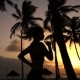 Girl Runs around in the Morning in the Palm Trees at Dawn - VideoHive Item for Sale