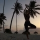 Girl Stretching Yoga in the Morning in the Palm Trees at Dawn - VideoHive Item for Sale