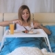 Woman Eating Breakfast Sausages With Fried Eggs On The Table, Lying In Bed - VideoHive Item for Sale