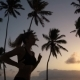 the Girl Runs Around in the Morning in the Palm Trees at Dawn - VideoHive Item for Sale