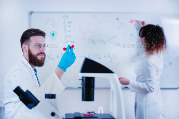 Young Researchers Working Together In The Lab - Stock Photo - Images