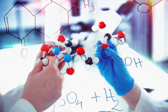 Hands holding molecular structure - Stock Photo - Images