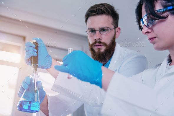 Young Scientist Doing Experiments In The Laboratory - Stock Photo - Images