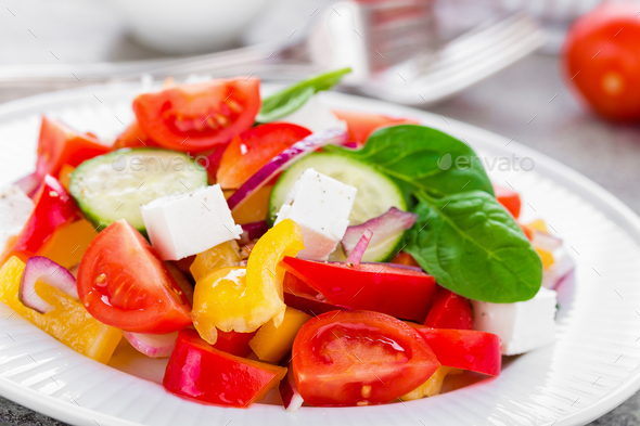Tomato salad with fresh bell pepper, red onion and feta cheese. Healthy eating - Stock Photo - Images