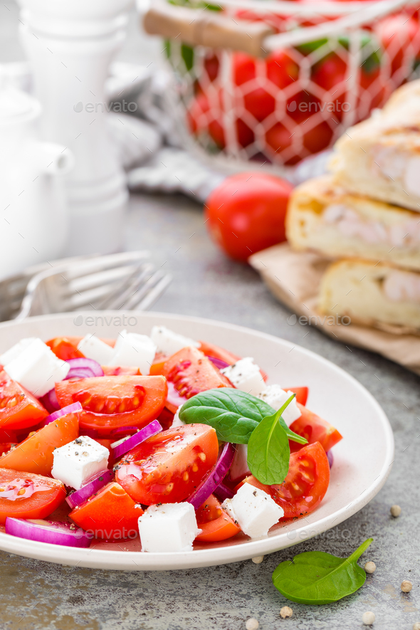 Tomato salad with fresh red onion and feta cheese. Healthy eating - Stock Photo - Images