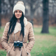 Female photographer taking pictures outdoors with a vintage camera - PhotoDune Item for Sale