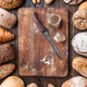 Delicious fresh bread on wooden background - PhotoDune Item for Sale