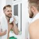 Morning hygiene, Man in the bathroom looking in mirror - PhotoDune Item for Sale