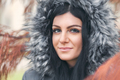 Beautiful woman wearing a fur hood winter coat - PhotoDune Item for Sale