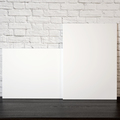 Two big blank frames on the wooden table. 3D illustration. - PhotoDune Item for Sale