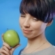 Attractive Brunette Girl Holding a Green Apple - VideoHive Item for Sale