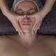 Close -Up of a Handsome Young Man Receiving Facial Massage at Spa Center - VideoHive Item for Sale