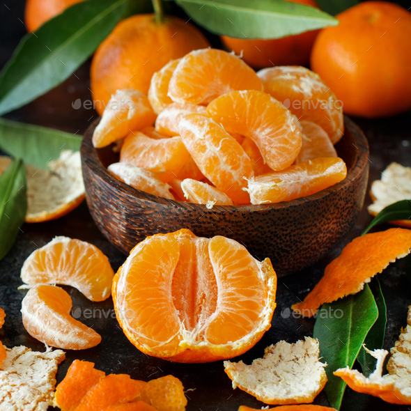 Mandarins with leaves in a bowl - Stock Photo - Images