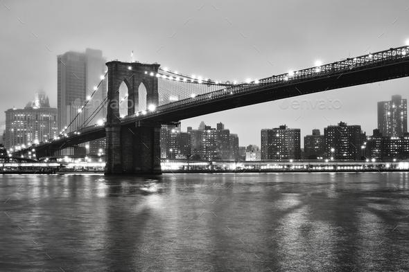 Brooklyn Bridge on a foggy night, New York, USA. - Stock Photo - Images