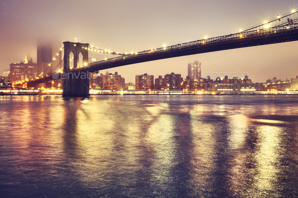 Brooklyn Bridge on a foggy night, New York, USA. - Stock Photo - Images