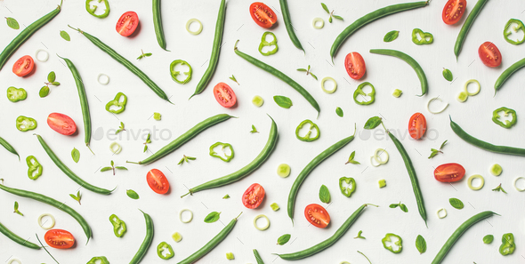 Fresh green beans and cherry tomatoes over white background - Stock Photo - Images