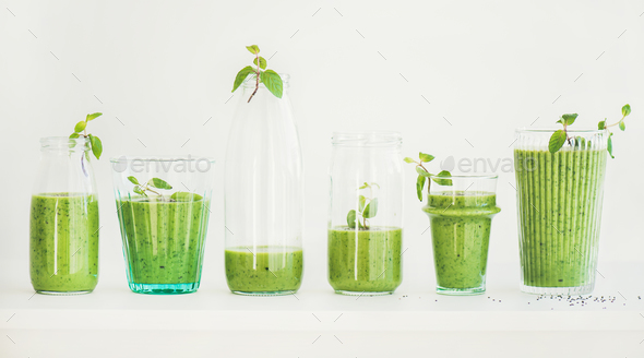 Matcha green smoothie with chia seeds in glasses and bottles - Stock Photo - Images