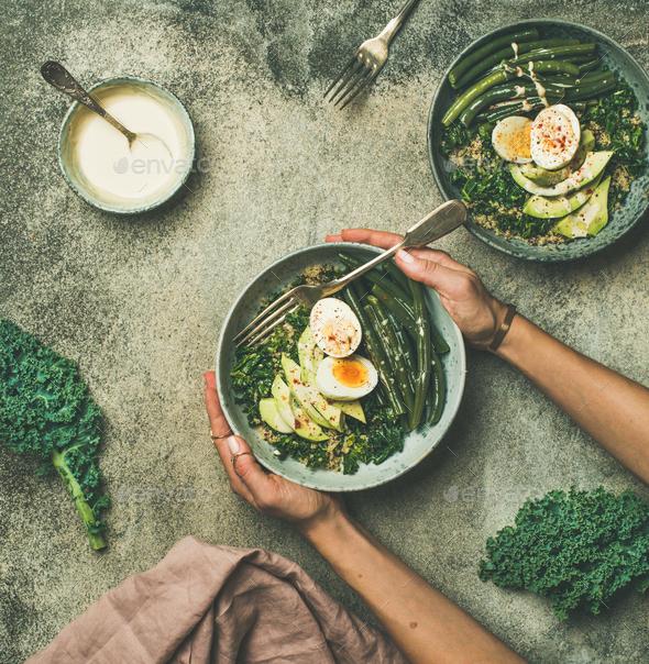 Quinoa, kale, beans, avocado, egg bowls, top view - Stock Photo - Images