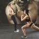 Young Sporty Couple Workout in Gym with Elastic Trx Equipment - VideoHive Item for Sale