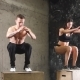Athletes Doing Box Squat Exercise in CrossFit Gym - VideoHive Item for Sale