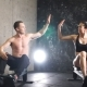 Man and Woman Giving High-Five While Doing Exercises With Rowing Machine at Gym. - VideoHive Item for Sale