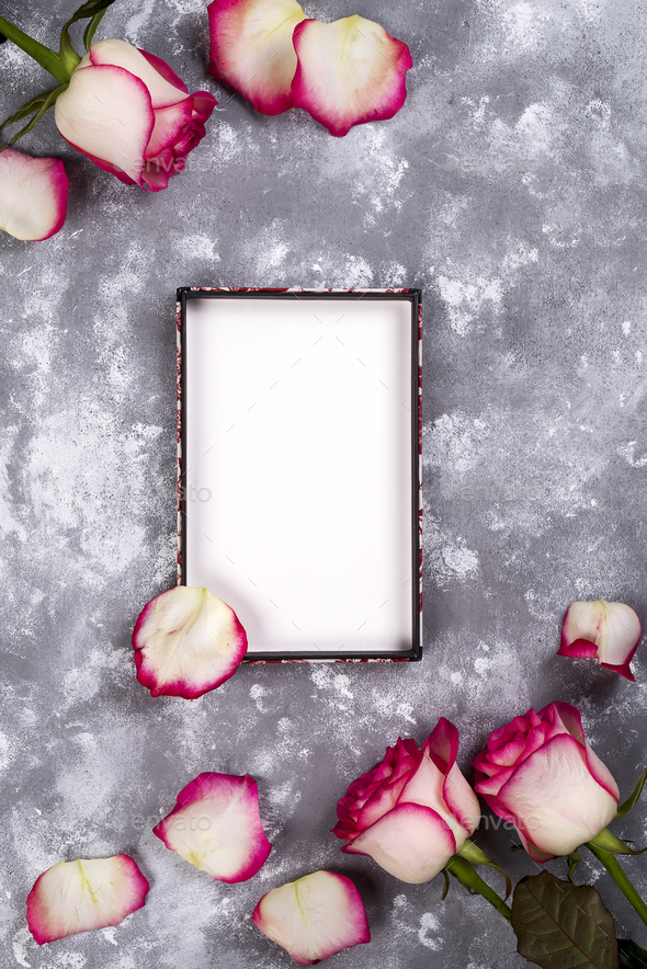 Floral frame: bouquet of pink white roses on stone background with copy space for text. - Stock Photo - Images
