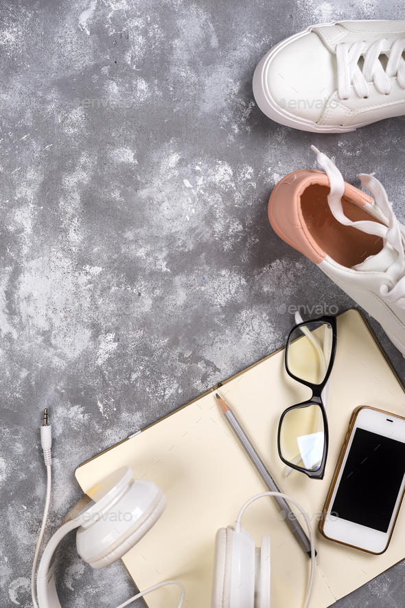 Summer holiday concept: smartphone , white sneakers, notepad, headphones, pen - Stock Photo - Images