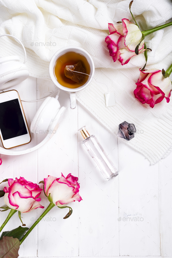 Fresh rose with tea and perfum - Stock Photo - Images