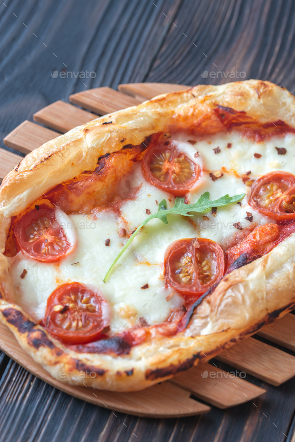 Mini pizzas on the wooden board - Stock Photo - Images