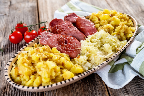 Leberkaese; Sauerkraut and roasted potatoes - Stock Photo - Images