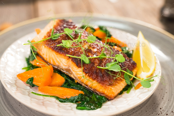 Salmon steak with carrot and spinach - Stock Photo - Images