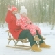 Happy Little Boy and His Grandfather on the Sledge in the Winter Park - VideoHive Item for Sale