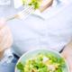 Girl eating fresh organic salad - PhotoDune Item for Sale